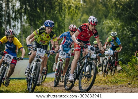 Sludorudnik, Russia - August 06, 2015:  group of boys mountain bike during Spartakiada among boys and girls in Cycling-mountain bike, Sludorudnik, Russia - August 06, 2015