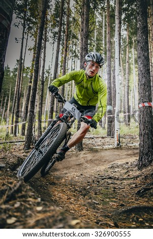Sludorudnik, Russia - September 13, 2015: racer on mountain bike rides on a u-turn during Blagikh Racing Cup mountain bike - stock photo
