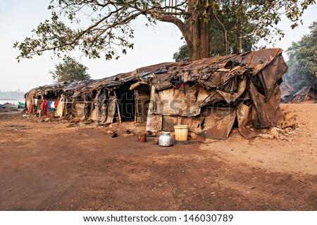Slum house near the river, Goa, India - stock photo