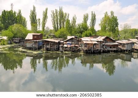 Slum houses near the river, Srinagar, India - stock photo