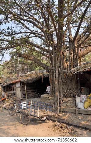 Slum in Kolkata during the sunny day, India. - stock photo