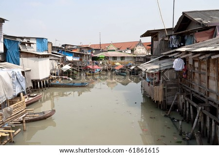 Slum on dirty canal in Jakarta, Indonesia - stock photo