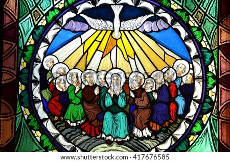 SLUPSK, POLAND - 21 MARCH 2016 stained glass window depicting Pentecost - stock photo