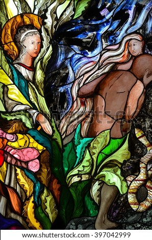 SLUPSK, POLAND - 27 MARCH 2016 - stained glass window depicting the expulsion of Adam and Eve - stock photo