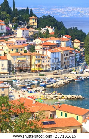 Small Adriatic sea harbor with fishing boats in front of traditional houses, Croatia
