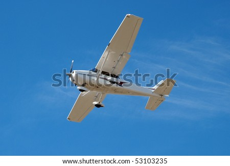 Small Aeroplane with flaps down coming in to land - stock photo