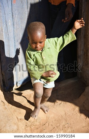 Small African child crying and running away from his parent - stock photo