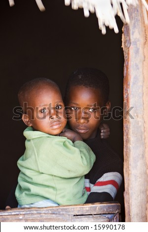 Small African children in the door of the village house - stock photo