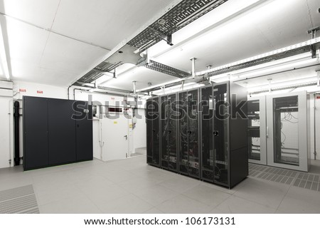 small air-conditioned  computer server room environment with racks - stock photo