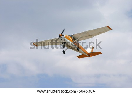 Small aircraft at the blue sky - stock photo