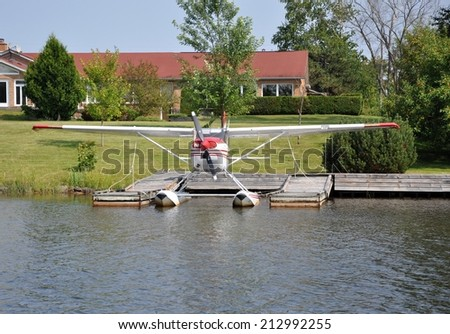 Small aircraft docked in a river - stock photo