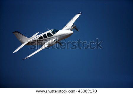 Small airplane against blue sky - stock photo