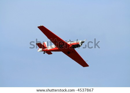 Small airplane doing aerial acrobatics at low altitude - stock photo
