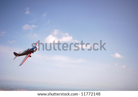 small airplane in blue sky - stock photo