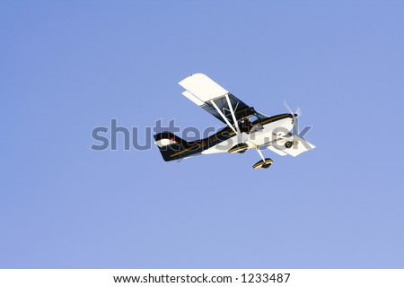 Small airplane over magnificent blue sky - stock photo