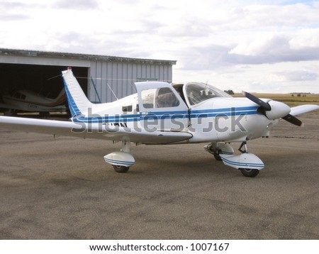 small airplane preparing for take off - stock photo