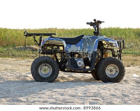 Small All Terrain Vehicle on a beach