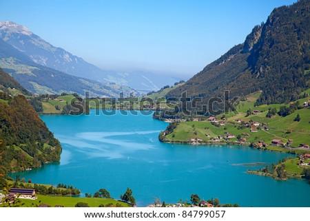 "Small alpine lake ""Lungernsee"" near Luzern in Switzerland - stock photo"