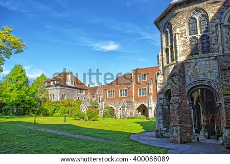Small ancient houses next to Canterbury Cathedral in Canterbury in Kent of England. It is one of the most famous cathedrals in England. It is the Archbishop of Canterbury Cathedral. - stock photo