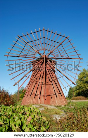 Small ancient wooden windmill in city park