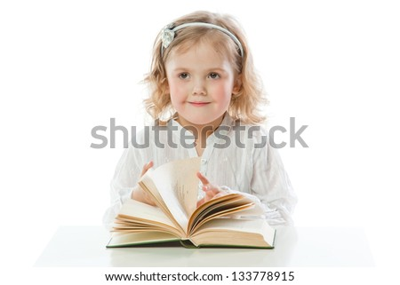 Small and beautiful girl reading a book