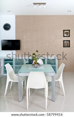 Small and contemporary dining room with TV - stock photo