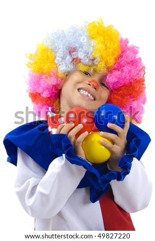 Small and happy clown holding balls . - stock photo