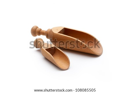 Small and large wooden spice spoons - stock photo