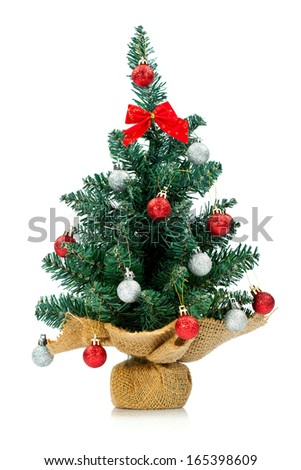 Small and lovely decorated Christmas tree isolated on white background.  - stock photo