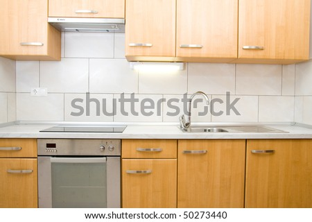 Small and modern kitchen in a new apartment. - stock photo