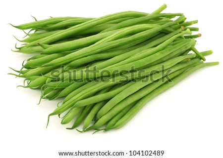 small and slender green beans (haricot vert) on a white background - stock photo