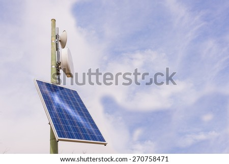 Small antenna booster with solar panel, in the mountains - stock photo