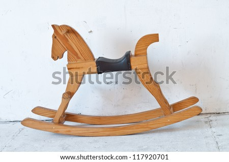 Small Antique brown wooden rocking horse toy. - stock photo