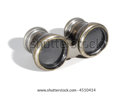 Small antique leather covered opera glasses (binoculars) isolated on white