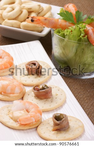 Small appetizer: prawn cocktail and finger food. Selective focus, shallow DOF - stock photo