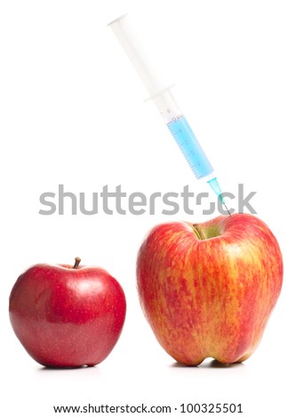small apple and a big one with syringe