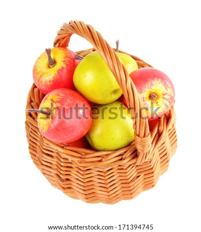 Small apples in wicker basket, isolated on white