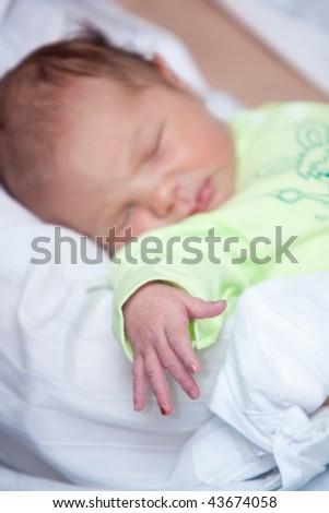 small arm of newborn baby - stock photo