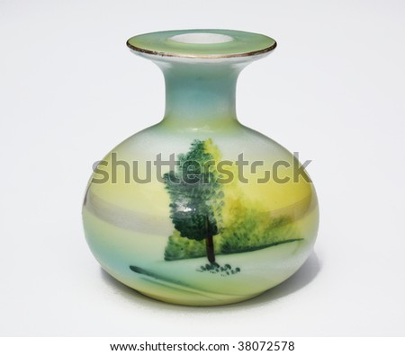 Small Asian vase with green tree on it - stock photo