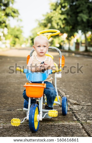 Small baby boy on bicycle