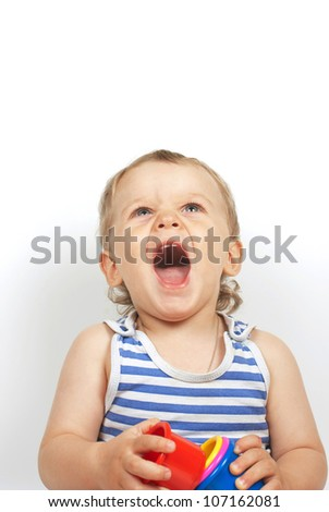 Small baby boy with a toy pyramid - stock photo