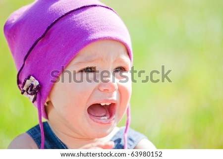Small baby girl spending time outdoor on a warm autumn day. - stock photo