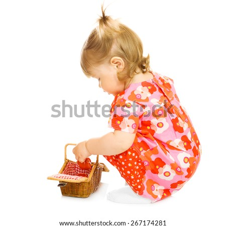 Small baby in red dress with toy basket isolated - stock photo