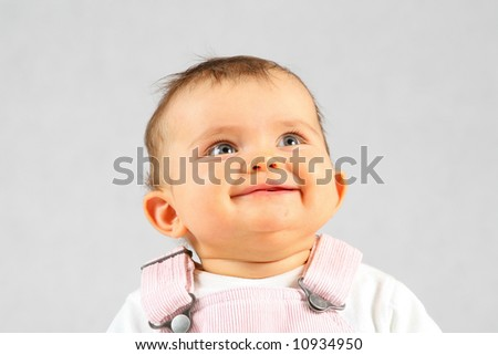 small baby is happy smiling over white background - stock photo