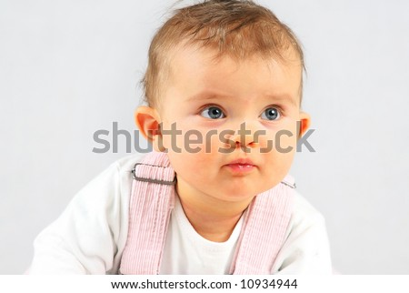 small baby is looking up over white background - stock photo