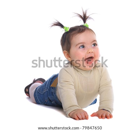 small baby  on her tummy - stock photo