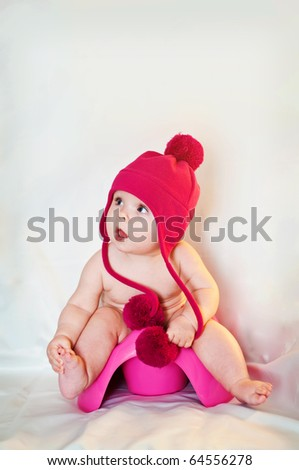 Small baby on the potty - stock photo