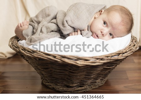 Small Baby sleeping inside wooden basket