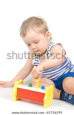 Small baby with a toy - stock photo