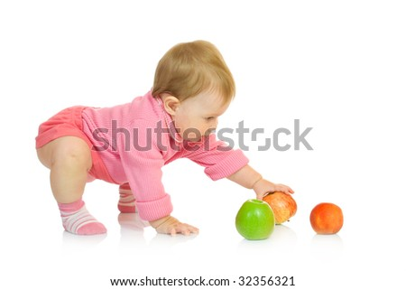 Small baby with apples - stock photo